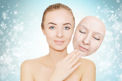 Christmas present: woman enjoys her healthy skin without wrinkle Royalty Free Stock Image