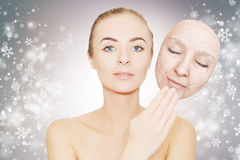 Christmas present: woman enjoys her healthy skin without wrinkle Stock Photo