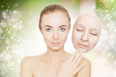 Christmas present: woman enjoys her healthy skin without wrinkle Stock Photos