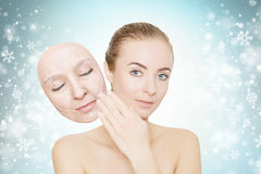 Christmas present: woman enjoys her healthy skin without wrinkle Royalty Free Stock Photo