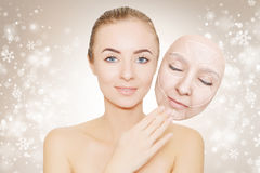Christmas present: woman enjoys her healthy skin without wrinkle Royalty Free Stock Photos