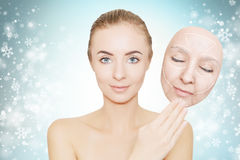 Christmas present: woman enjoys her healthy skin without wrinkle Stock Image