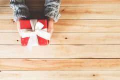 Christmas present in woman hands from above Royalty Free Stock Photo