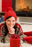 Christmas present woman lying floor home fireplace Royalty Free Stock Images