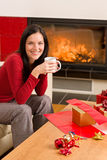 Christmas present wrap woman drink home fireplace Stock Image