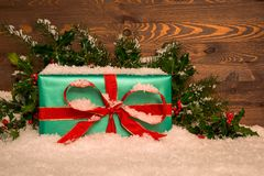 Christmas present wrapped in green paper with red ribbon Royalty Free Stock Image