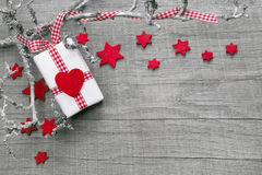 Free Christmas Present Wrapped In Red Paper On A Wooden Background Stock Image - 34433641