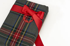 Christmas present,wrapped in plaid, red tie and decorative star Stock Photos