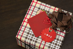 Christmas present,wrapped in plaid, red tie and decorative star Royalty Free Stock Images
