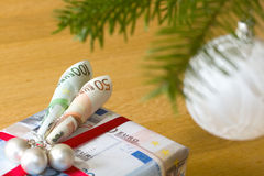 Christmas present. Wrappend in bank notes wrapping paper Royalty Free Stock Image