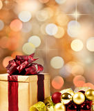 Christmas present with xmas bubbles and ribbon. Christmas Present with decorative xmas bubbles and ribbon (gold, red and green Royalty Free Stock Images