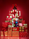 Christmas Presents. And Gifts. Over red  background Royalty Free Stock Photo