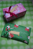 Christmas presents. Two christmas presents, pink & green royalty free stock images