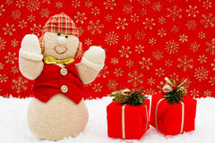 Christmas Presents. Two red Christmas presents with a snowman on a red snowflake background, snowman Stock Images