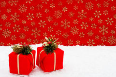 Christmas Presents. Two red Christmas presents on a red snowflake background, snowman Stock Photography