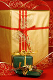 Christmas presents. Some Christmas presents with decorations and ribbon over a red background Royalty Free Stock Images