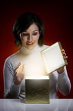Christmas presents. A beauty young girl with christmas gift Royalty Free Stock Image