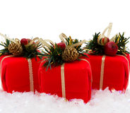 Christmas Presents. Three red christmas presents on snow with a white background, christmas  time Royalty Free Stock Photo