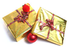 Christmas presents. Two Christmas presents with red Christmas ornaments Royalty Free Stock Image