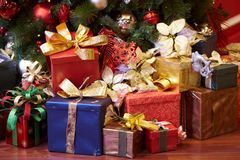 Christmas Presents. A group of colorful Christmas presents under a Christmas tree stock image