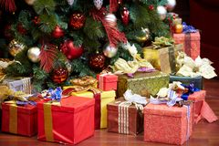 Christmas Presents. A group of colorful Christmas presents under a Christmas tree stock photography