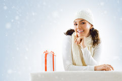 Christmas presents. A beauty young girl with christmas gift Royalty Free Stock Images