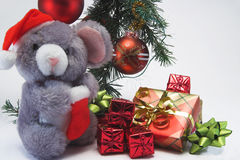 Christmas presents. Presents under the Christmas tree with a Christmasy soft toy Stock Photography