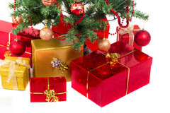 Christmas presents. Gift boxes under the Christmas tree over white Royalty Free Stock Photography