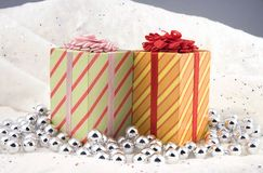 Christmas presents. Some Christmas holiday presents photographed indoors against a snow type cloth background Royalty Free Stock Photo