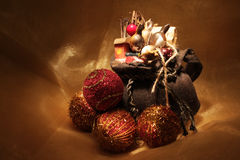 Christmas presents. Gift bag with presents and christmas colorful balls Stock Images