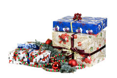 Christmas Presents. Surrounded by decorations for the season Stock Photography