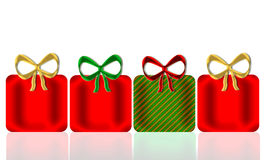 Christmas Presents. Four shining decorative presents and bows in Christmas colors of red, green, and gold with mirror reflection below for added depth and all on Stock Image