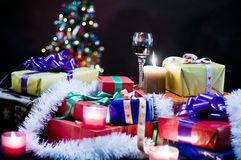 Christmas presents. Close up of pile of colorful Christmas presents with tree in black background stock photos
