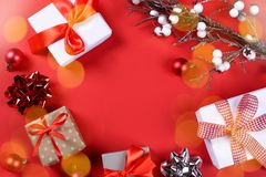 Christmas presents and accessories on red royalty free stock images