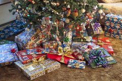 Christmas presents around tree Stock Image