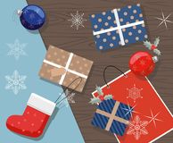 Christmas presents, balls and gift package on a table. Top view. royalty free illustration