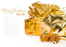Christmas presents and balls in the snow Royalty Free Stock Photo