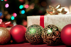 Christmas presents and baubles Royalty Free Stock Photography