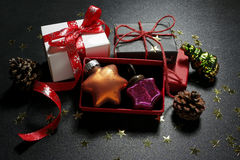 Christmas presents with baubles, cones and shine gold stars Stock Photography