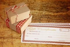 Christmas Presents and Blank Gift Certificate. Er on a Wooden Table stock photography