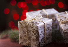 Christmas presents on blurred red lights background. Christmas present on blurred red lights background.Defocused Light royalty free stock photo