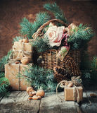 Christmas Presents Boxes with Cord, Basket, Coniferous and Fir tree Toys, Walnuts, Almonds on Wooden Background Stock Photography