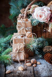 Christmas Presents Boxes Decorated with Cord, Basket, Coniferous and Fir Tree Toys, Walnuts, Almonds. Vintage Style Royalty Free Stock Images
