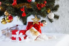 Christmas presents boxes under the fir tree Royalty Free Stock Photography