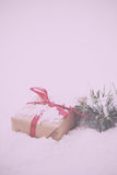 Christmas presents in brown paper with red ribbon Vintage Retro Royalty Free Stock Photo