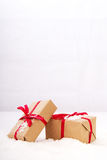 Christmas presents in brown paper with red ribbon Stock Image