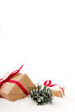 Christmas presents in brown paper with red ribbon Stock Photo
