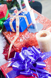 Christmas presents and candles Royalty Free Stock Photos