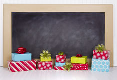 Christmas presents with chalk board Royalty Free Stock Images