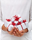 Christmas presents in child hands Royalty Free Stock Photo